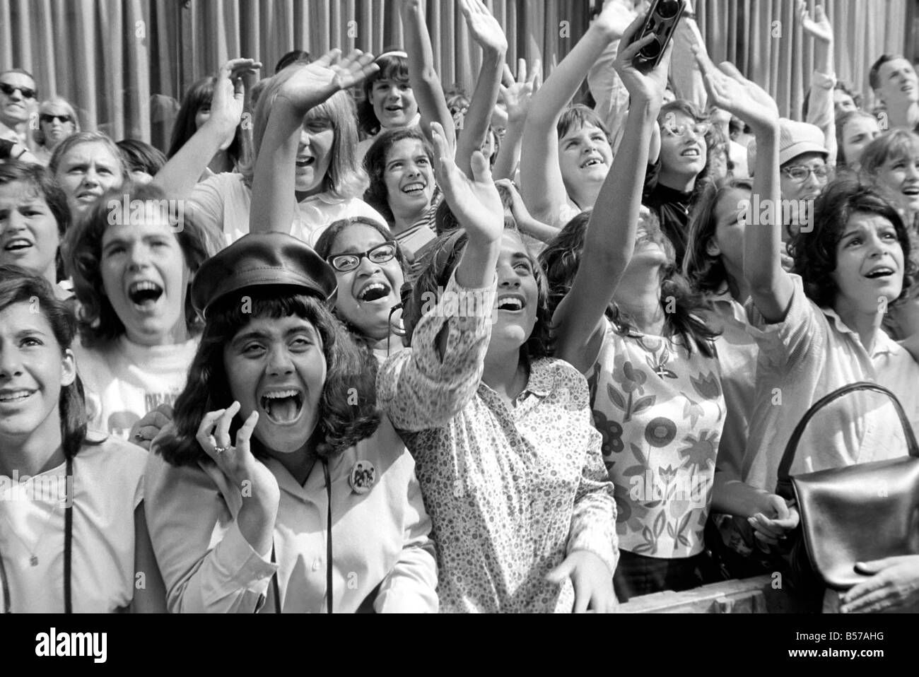 Screaming Beatles fans cheer for their idols on the ...