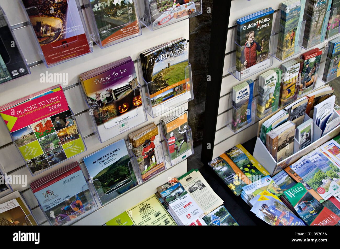 Tourist brochures and information leaflets at visitor centre Wales UK - Stock Image