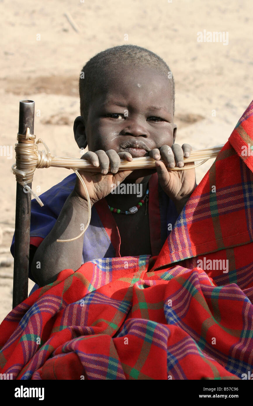 Dinka child in a cattle camp near Akot South Sudan - Stock Image