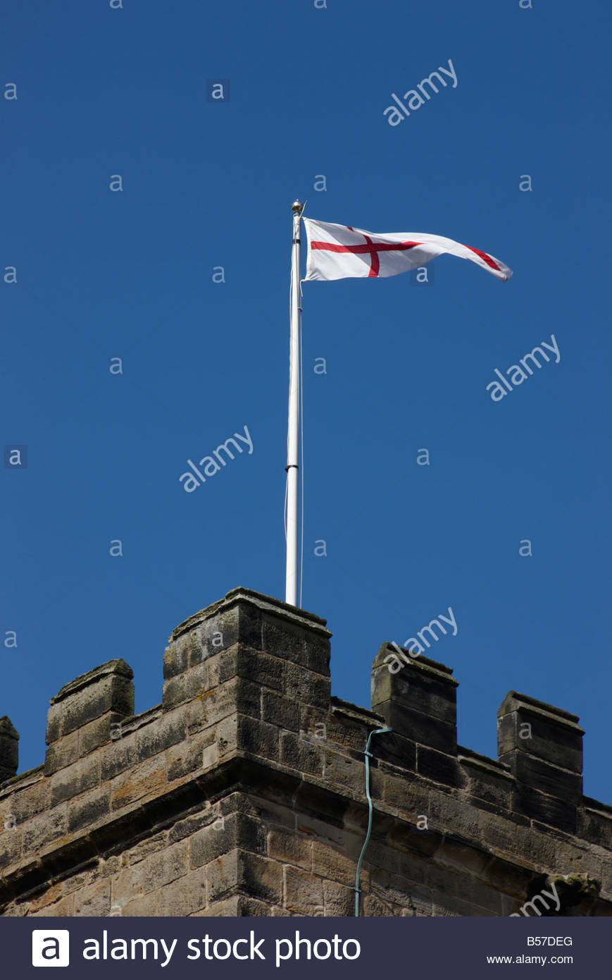 The English flag of St George on flagpole on tower of St Michael with St Mary Melbourne Derbyshire England - Stock Image