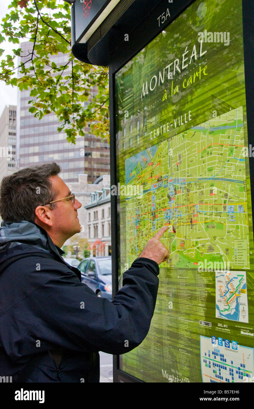Visitor looking at Montreal street map - Stock Image