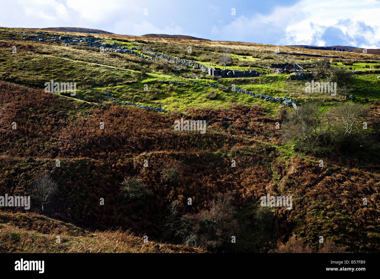 Ruined barn in industrial landscape with mining inclines Pwll Du hillside near Blaenavon Wales UK - Stock Image