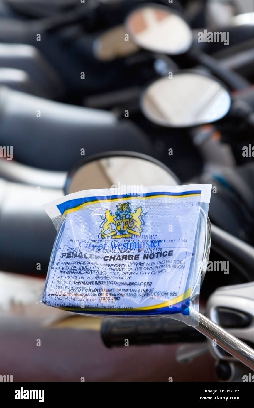 Penalty charge Notice on a motorbike, London, UK - Stock Image