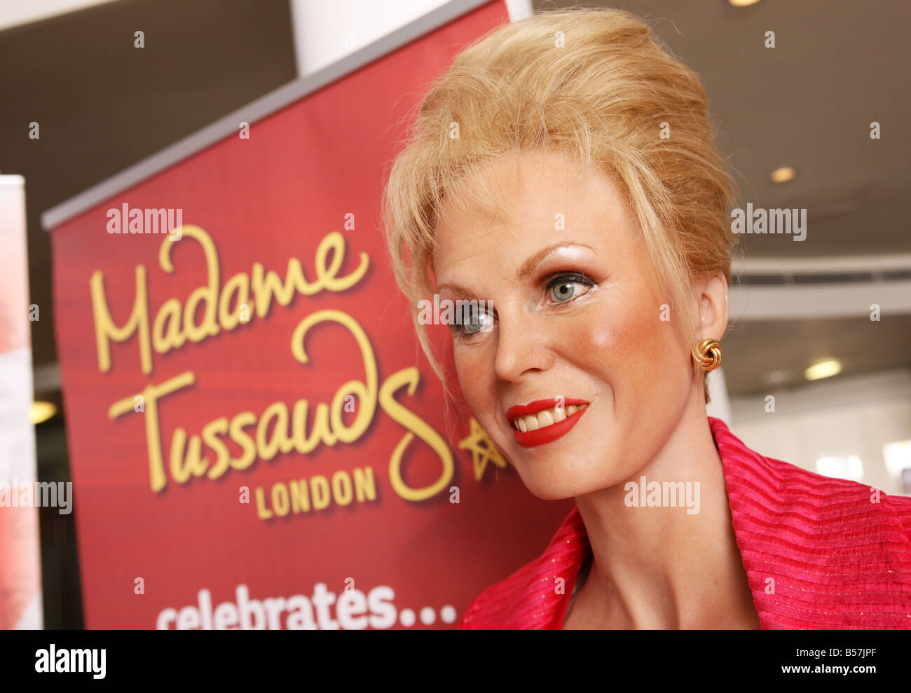 Waxwork of Joanna Lumley in front of a Madame Tussaud's poster - Stock Image
