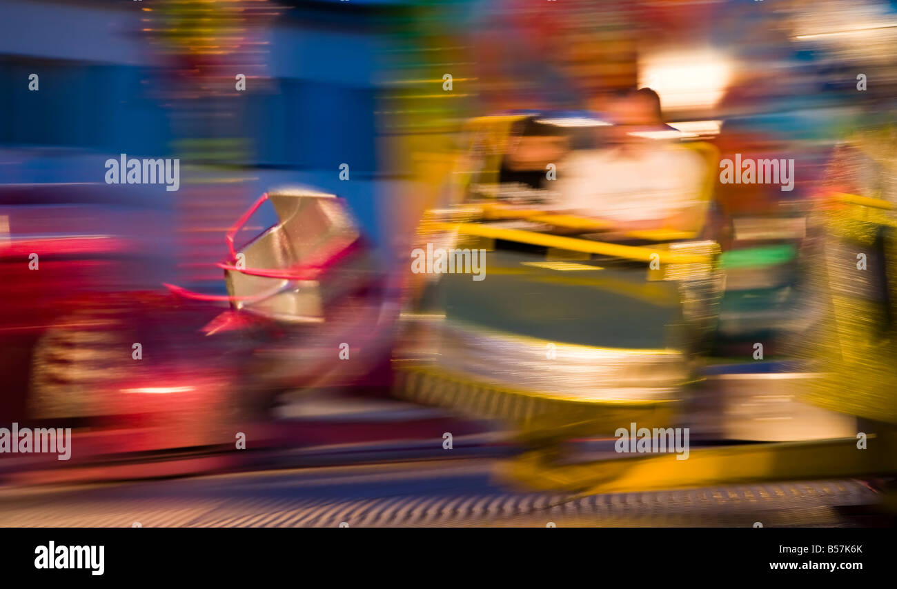 People blurred on a fast moving whirling waltzer at fairground Leba Poland - Stock Image