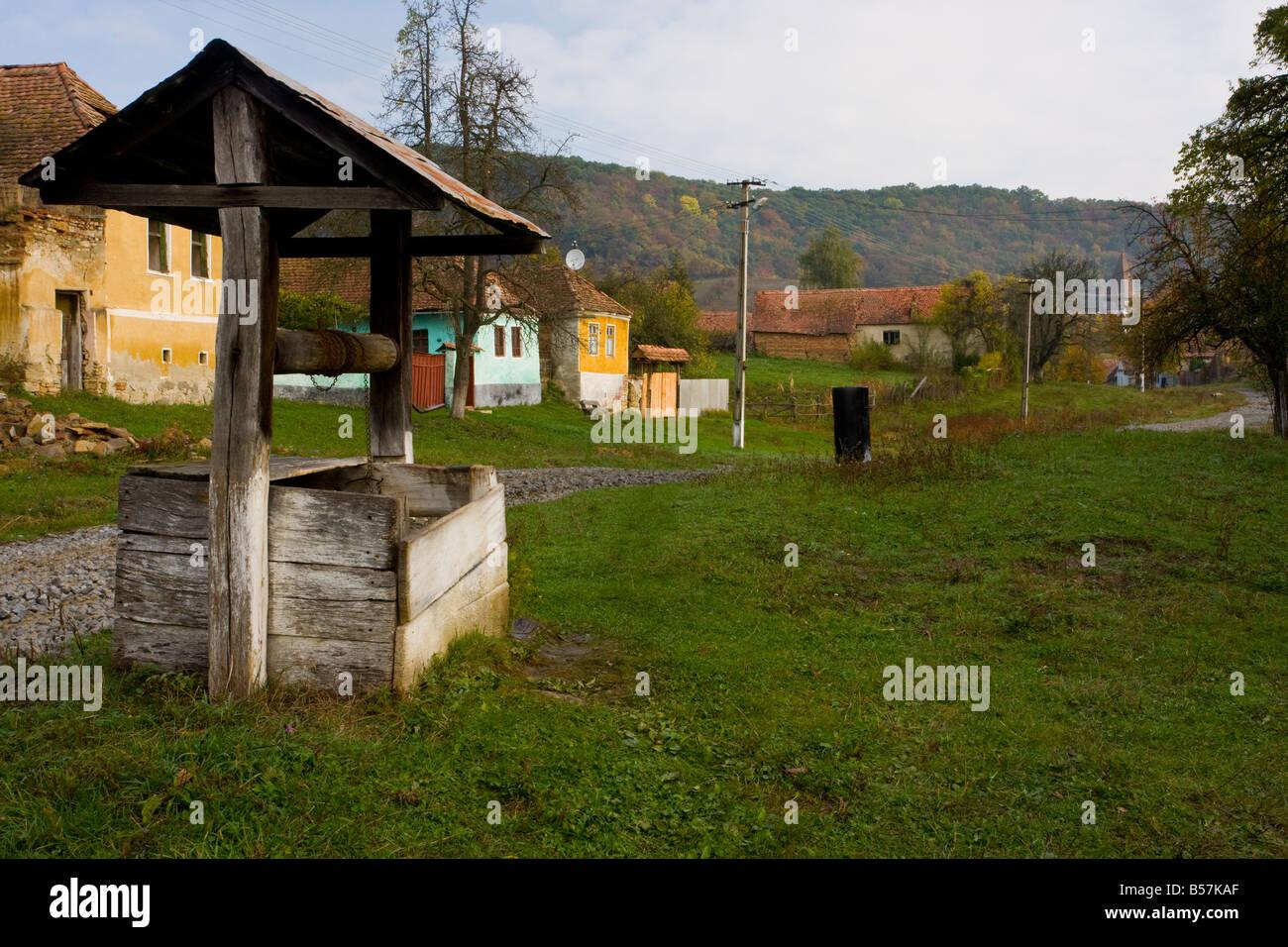 Traditional old well in the saxon village of Mesendorf or Meschendorf saxon villages Transylvania Romania Stock Photo