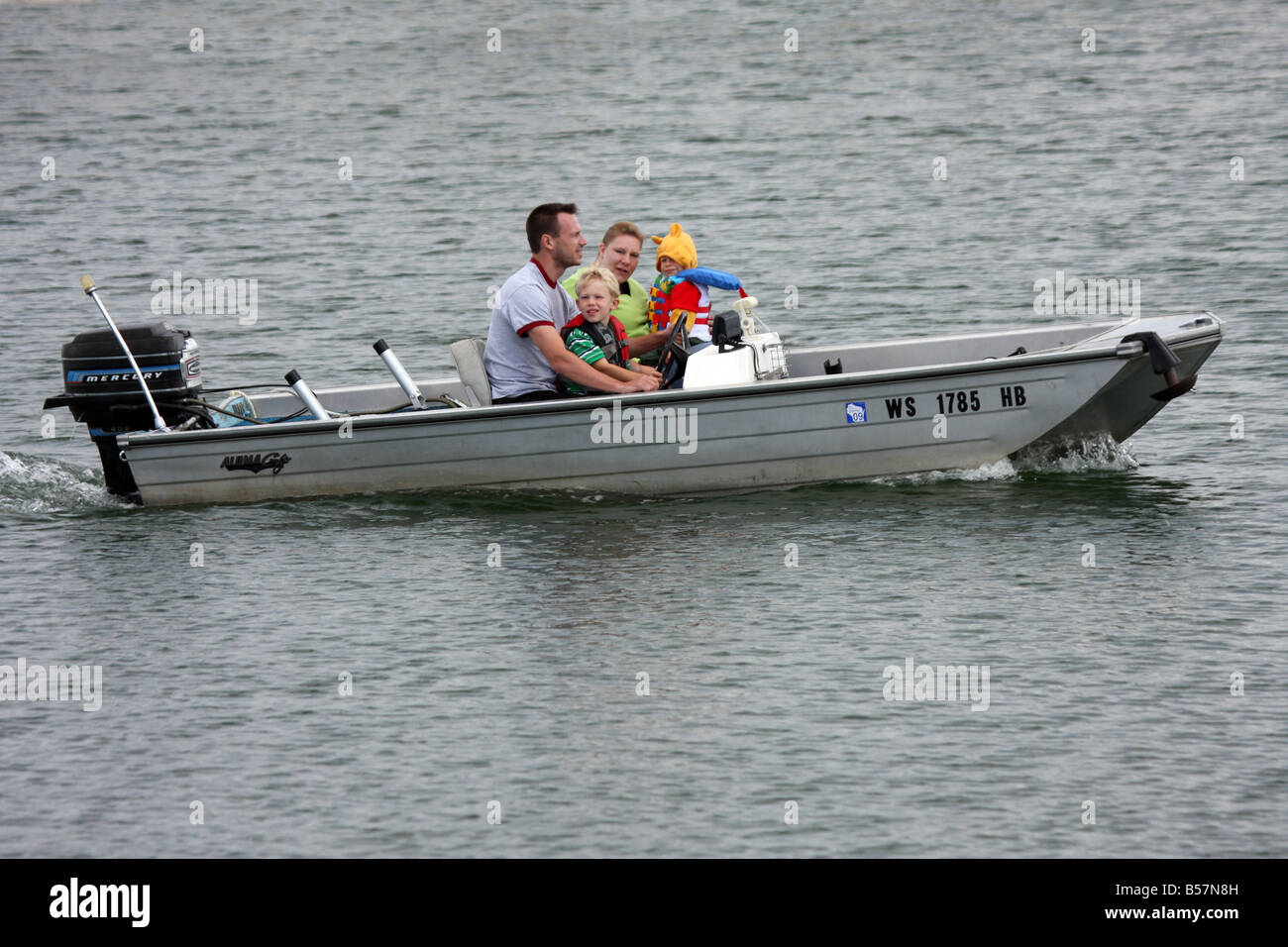 A family taking the boat out in the Milwaukee Harbor Wisconsin - Stock Image