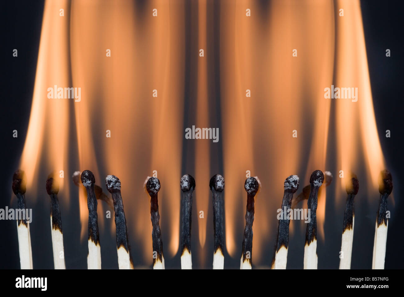 Row of burning matches - Stock Image