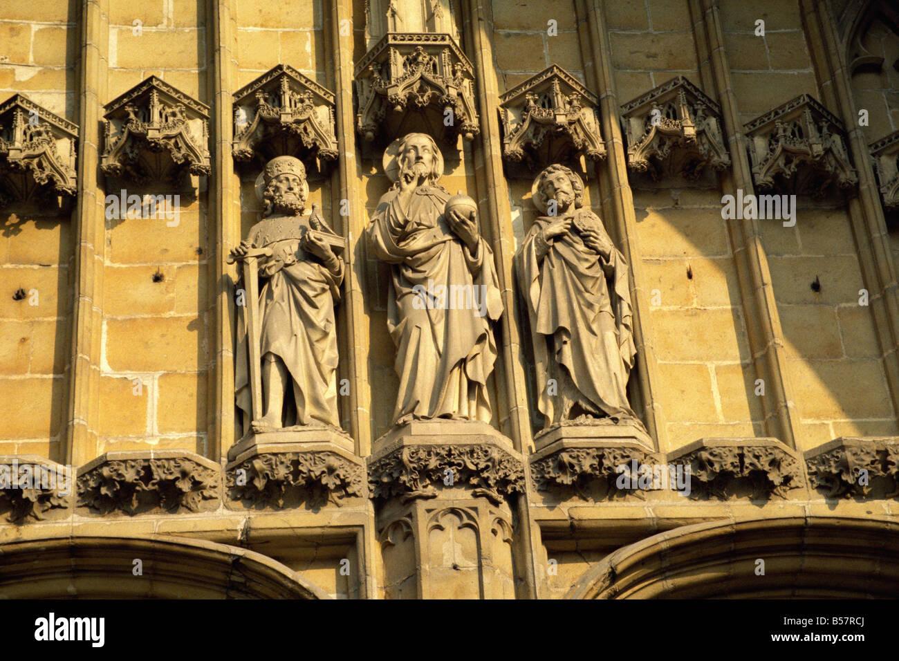 Religious statuary west door St Baafskathedraal Ghent Belgium Europe - Stock Image