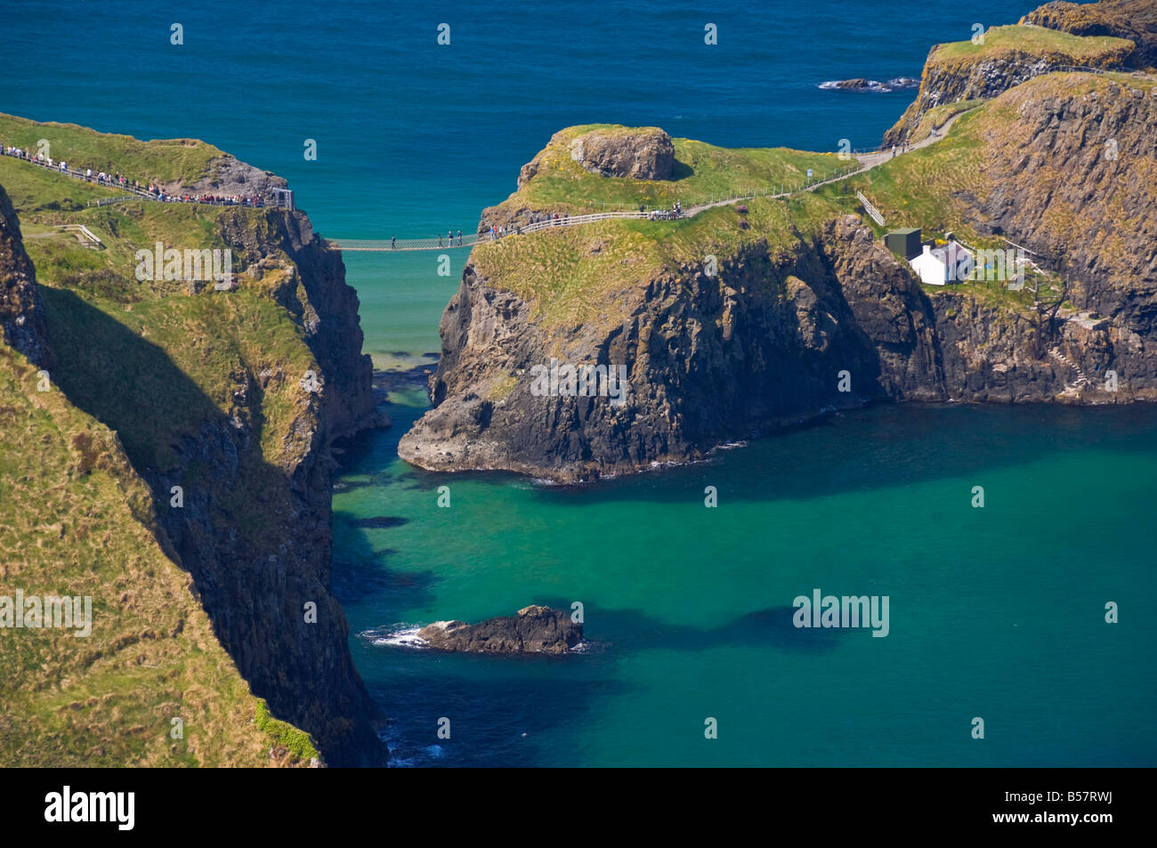 Carrick-a-Rede rope bridge to Carrick Island, Larrybane Bay, Ballintoy, Ballycastle, County Antrim, Ulster, Northern - Stock Image