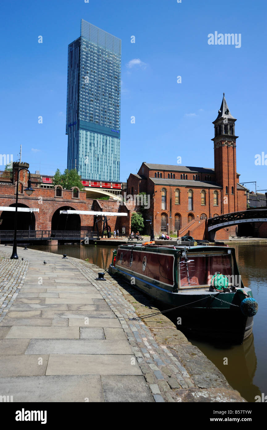 Canal boat at Castlefield with the Beetham Tower in the background, Manchester, England, United Kingdom, Europe - Stock Image