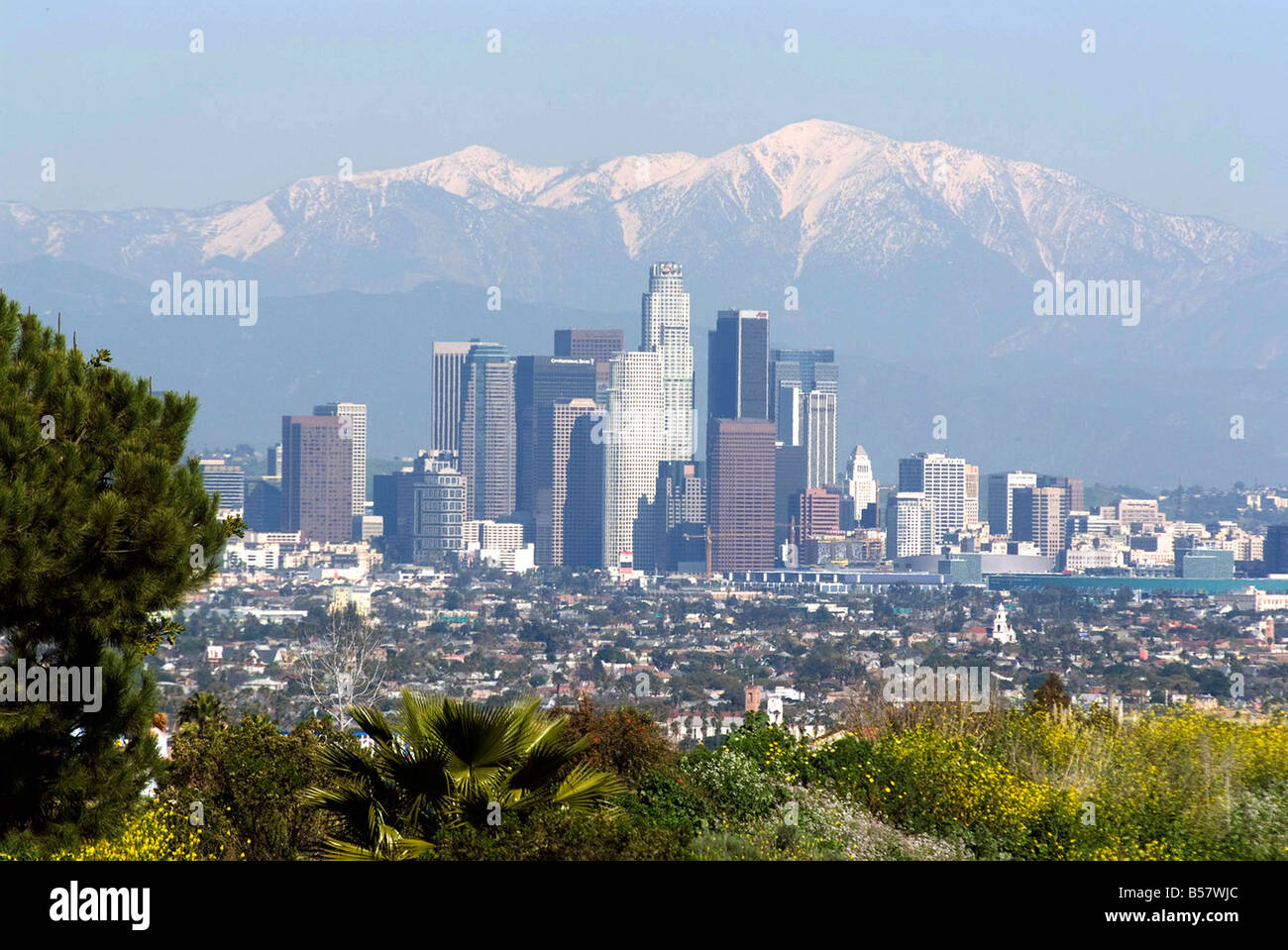 View of downtown Los Angeles looking towards San Bernardino Mountains, California, United States of America, North - Stock Image