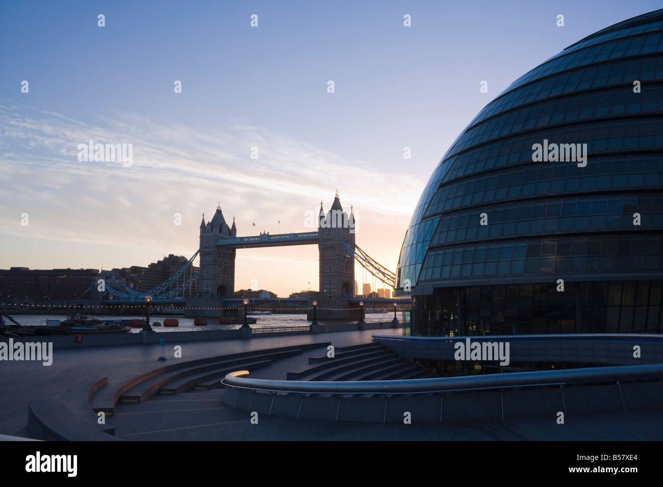 City Hall (London Assembly building) on Queens Walk, with Tower Bridge beyond, London, England, United Kingdom, - Stock Image