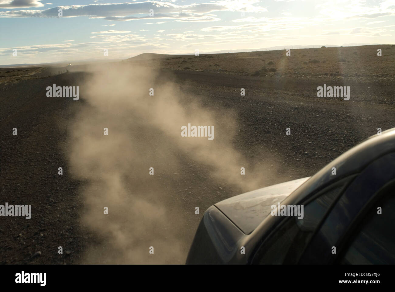 Dust kicks up from behind of car in Patagonia, on the infamous Route 40, Southern Argentina, South America - Stock Image