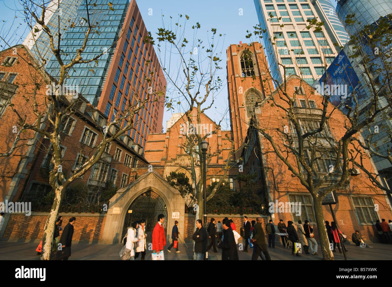A Christian church among modern skyscrapers on Renmin Square, Puxi area, Shanghai, China, Asia - Stock Image