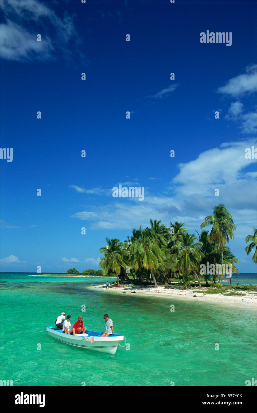 Tourists in boat, Laughing Bird Cay, Belize, Central America - Stock Image