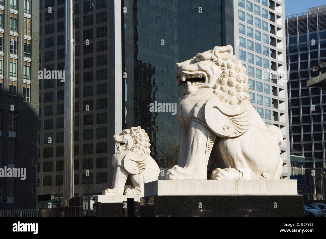 A stone lion statue in the CBD business district, Beijing, China, Asia - Stock Image