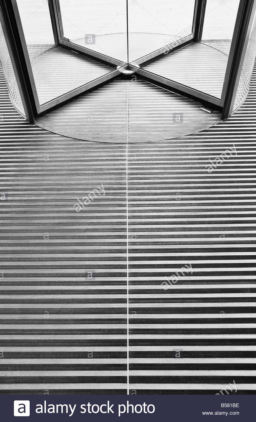 Revolving door and floor - Stock Image