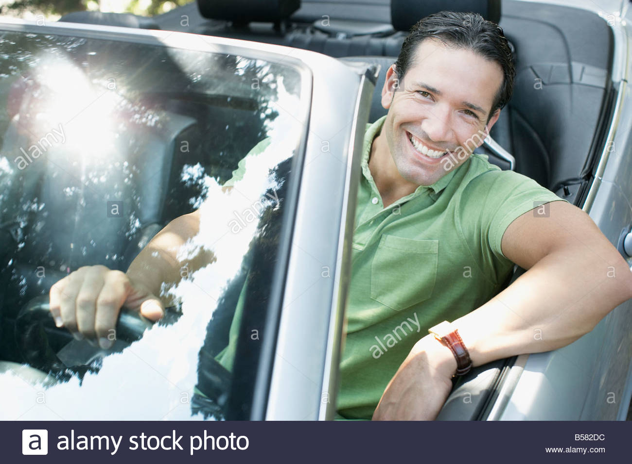 Man driving convertible sports car - Stock Image