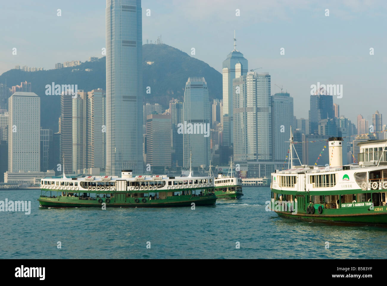 Star Ferries plying Victoria Harbour, Hong Kong, China, Asia - Stock Image
