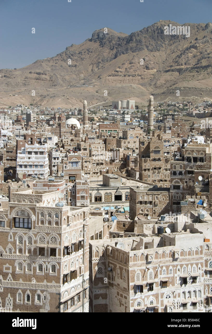 Traditional ornamented brick architecture on tall houses in Old City, Sana'a, UNESCO World Heritage Site, Yemen, - Stock Image