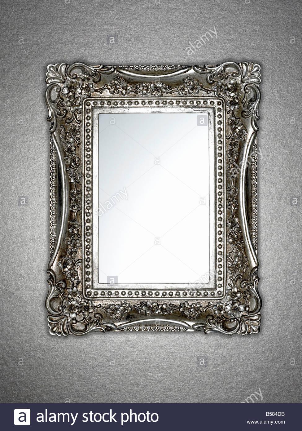 Ornately framed mirror - Stock Image