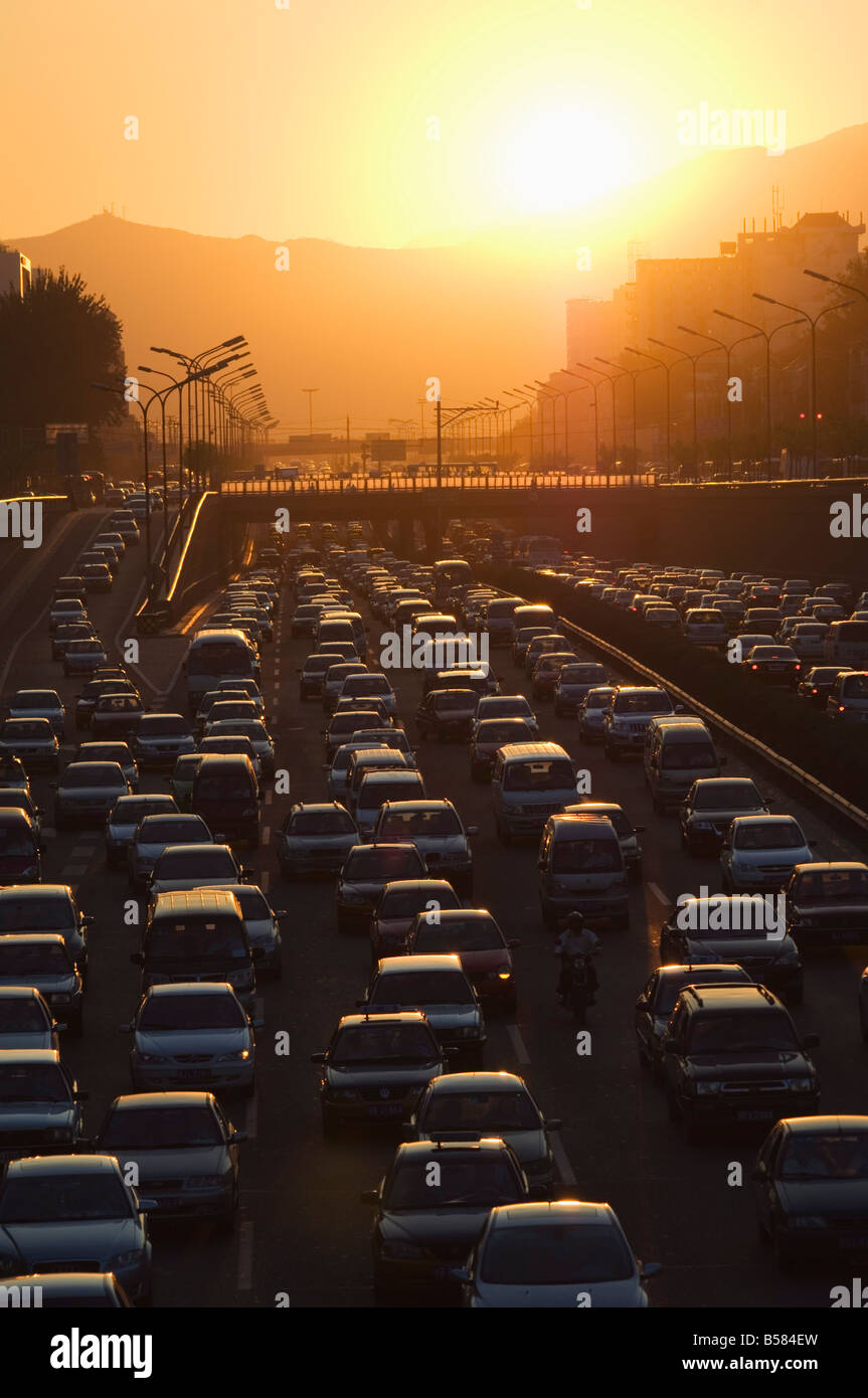 Sunset over city ring road during rush hour, Beijing, China, Asia - Stock Image