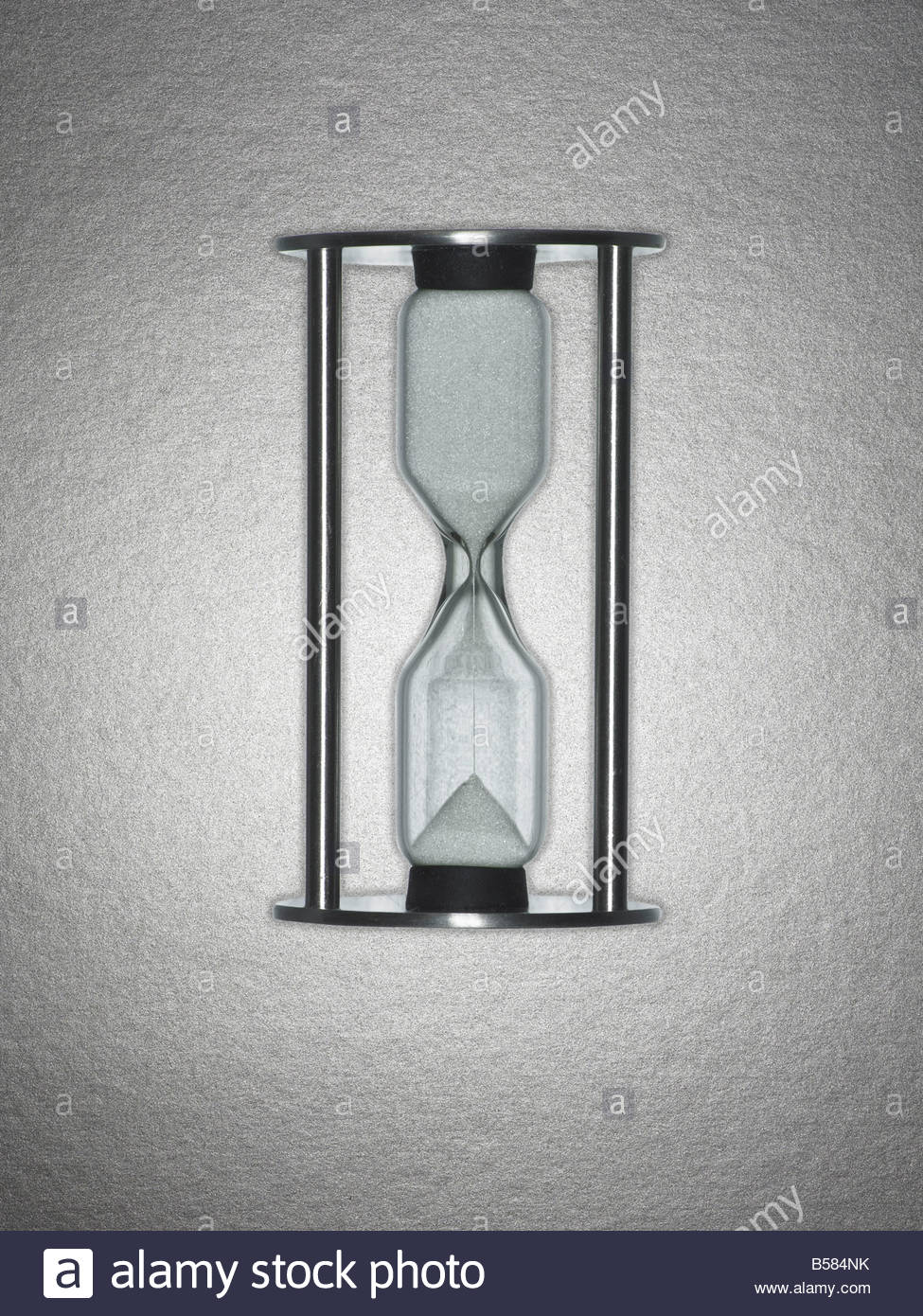 Hourglass draining sand - Stock Image