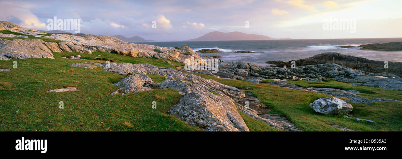 View towards the southern tip of the Isle of Harris from Taransay at dusk, Outer Hebrides, Scotland, United Kingdom, - Stock Image