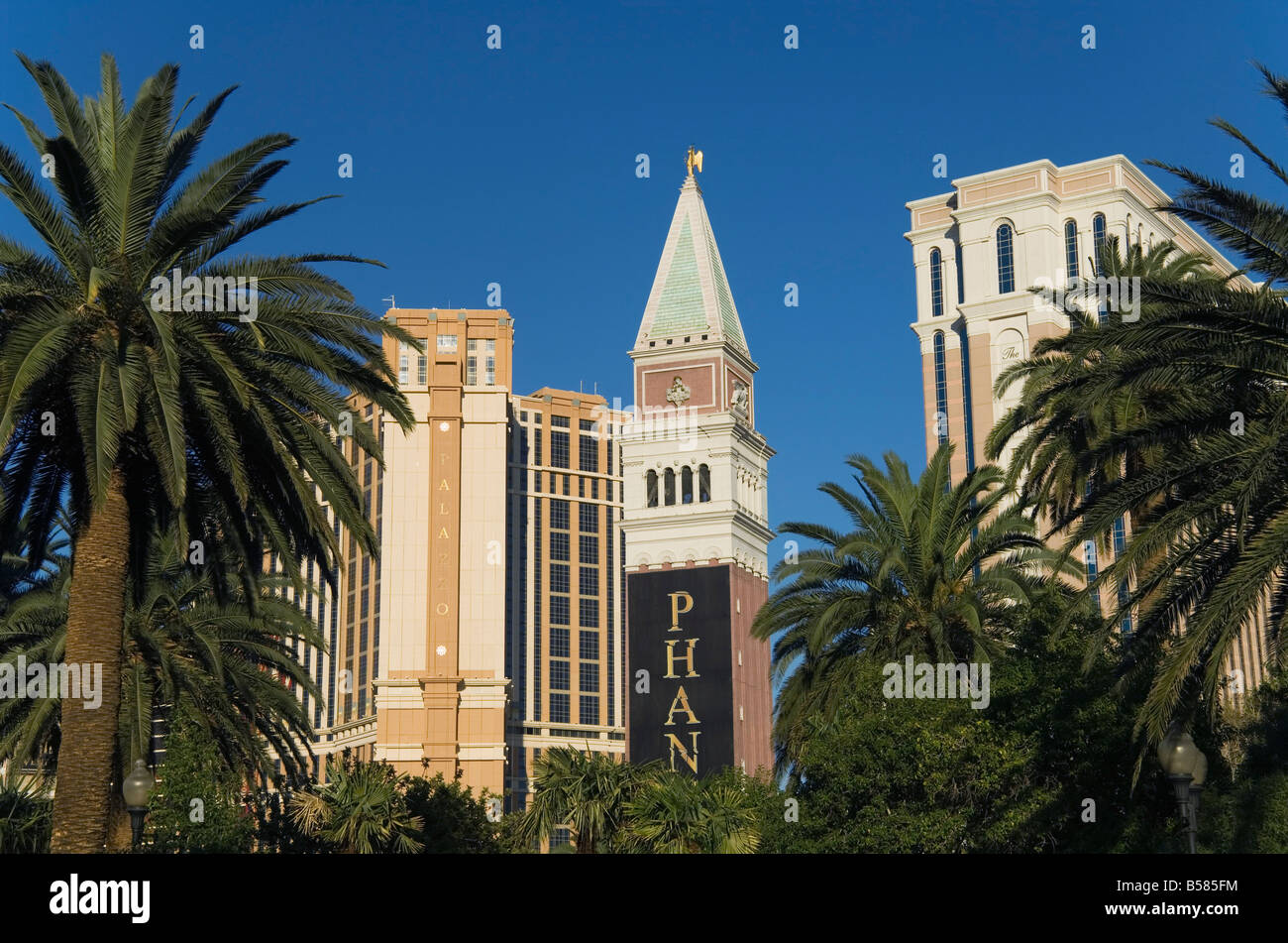 Venetian tower with Venetian Hotel on right, on the Strip (Las Vegas Boulevard), Las Vegas, Nevada, United States - Stock Image