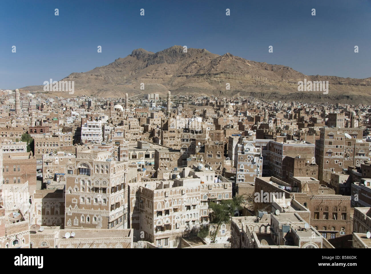 View across Old City of traditional tall brick-built houses, Sana'a, UNESCO World Heritage Site, Yemen, Middle - Stock Image