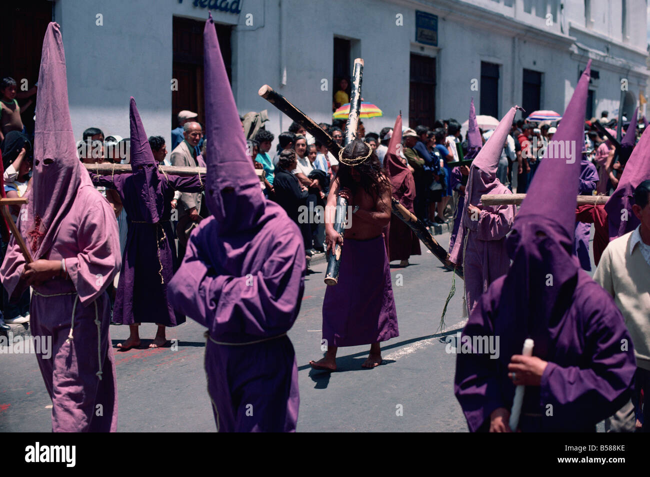 Penitents in Easter parade, Quito, Ecuador, South America - Stock Image