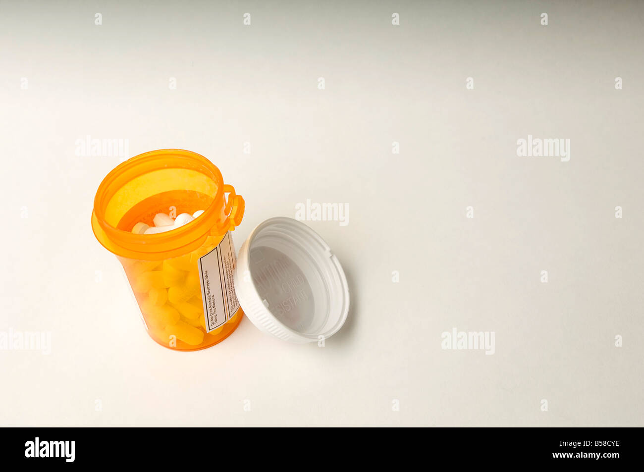Generic Vicodin Hydrocodone in a pharmacy distributed tablet container - Stock Image