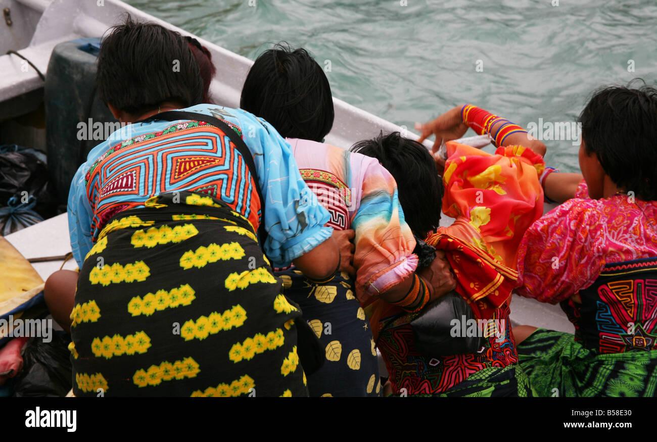Kuna Women Board a Boat, Capurgana, Colombia - Stock Image