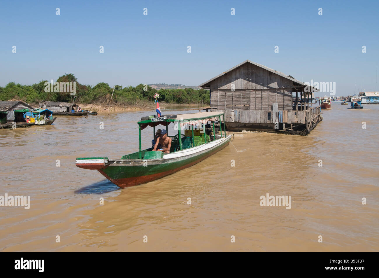 Floating house being moved, Tonle Sap Lake, near Siem Reap, Cambodia, Indochina, Southeast Asia - Stock Image