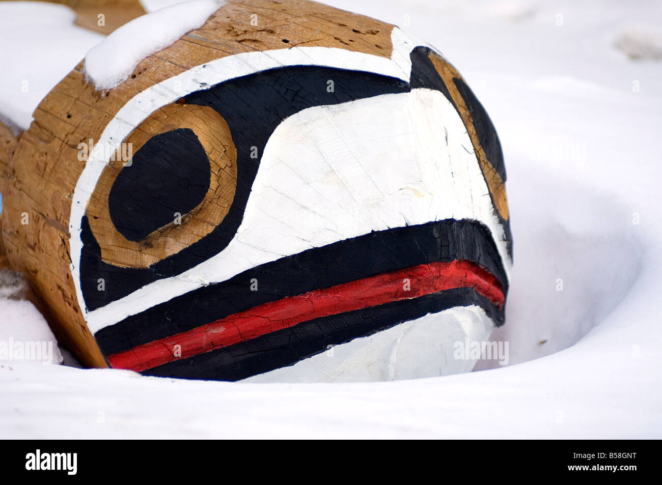 First nation carved bench in snow, Banff, Alberta Canada, North America - Stock Image