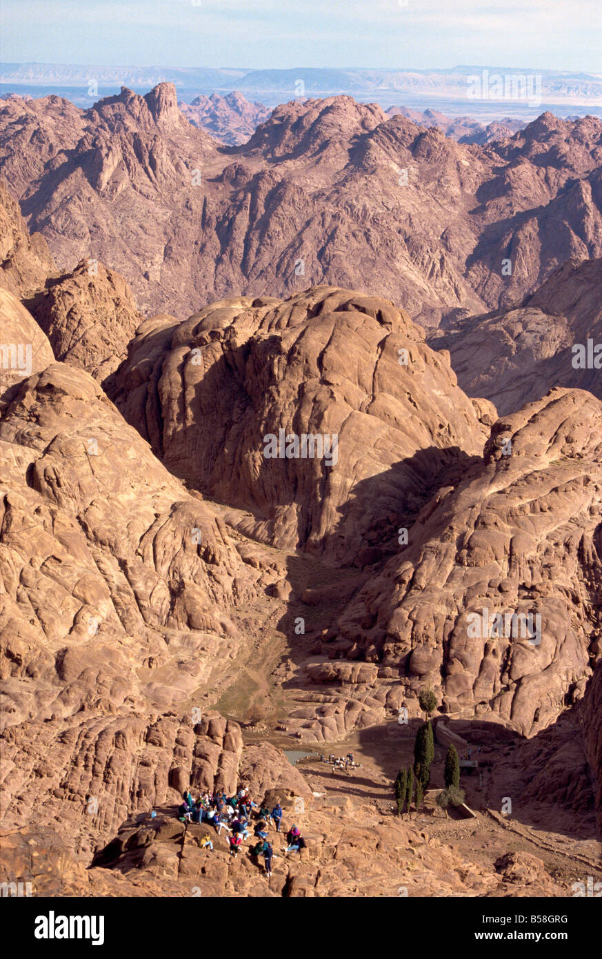 Christian pilgrims at prayer in the granite landscape of Mount Sinai and Mount Moses Egypt North Africa Africa - Stock Image