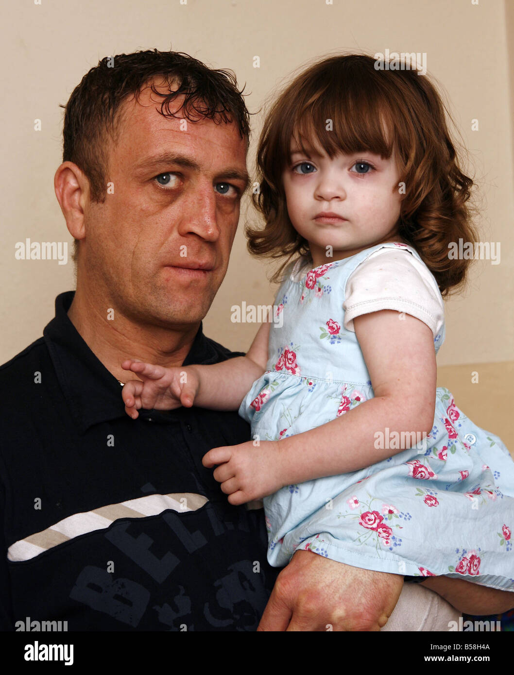 Simon Williams with his daughter Katie who needs a heart transplant because she was diagnosed Dilated Cardiac Myopathy - Stock Image