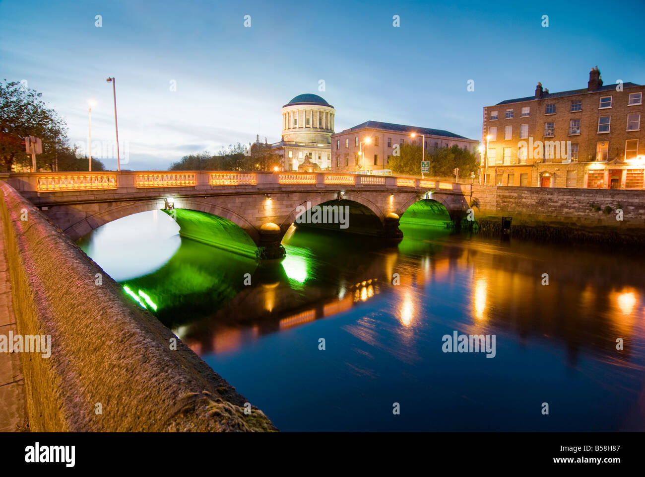 The O Donavan Rossa Bridge and Four Courts as seen from Wood Quay - Stock Image