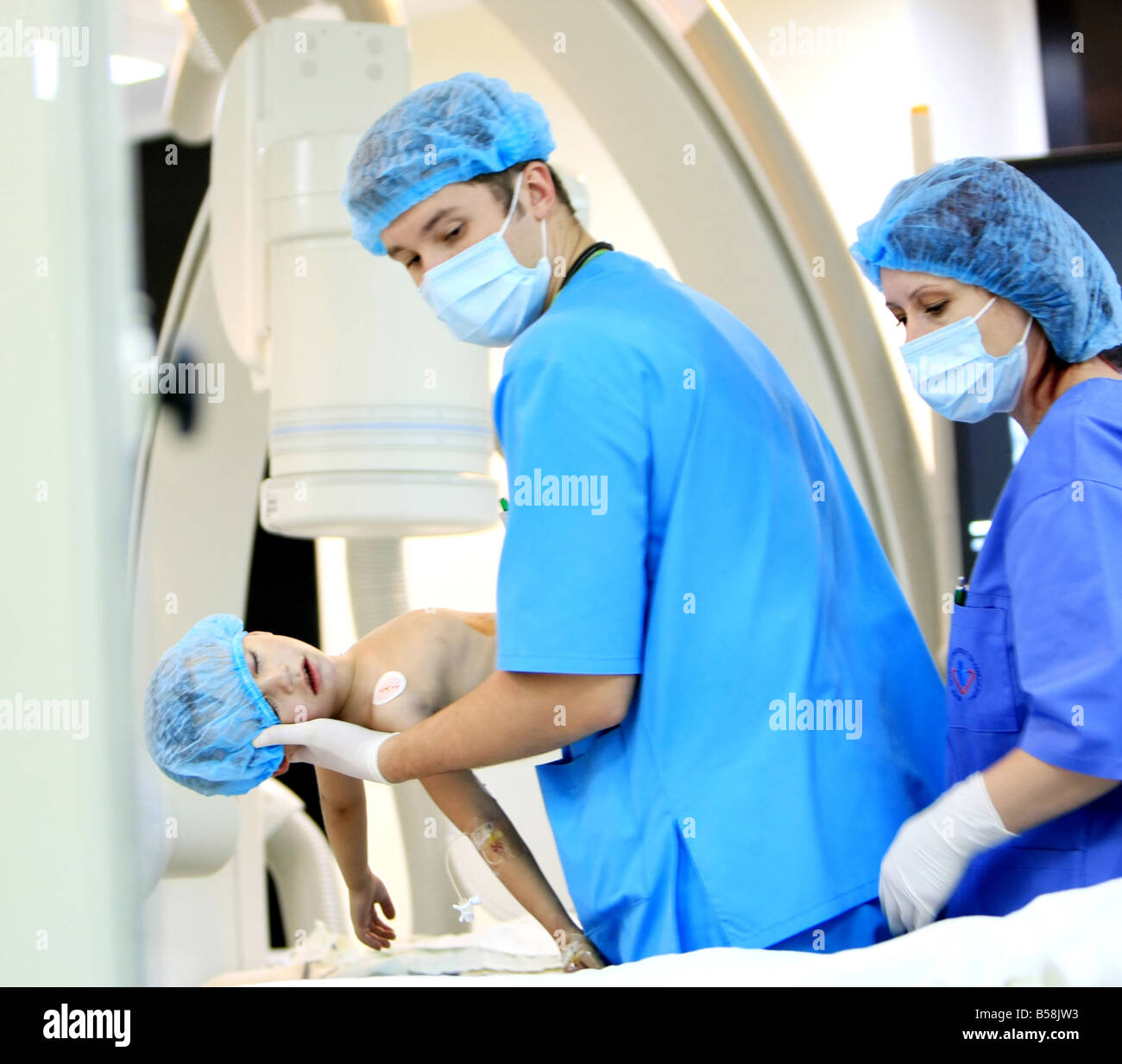 Doctor take care of a boy at operating room - Stock Image