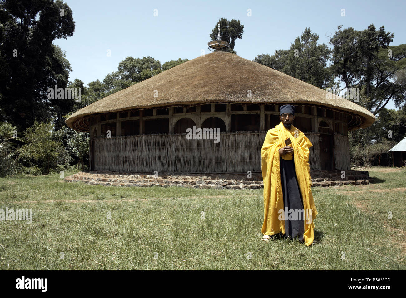 A priest stands in front of the monastery of Ura Kidane Meret, on Lake Tana, Ethiopia, Africa - Stock Image