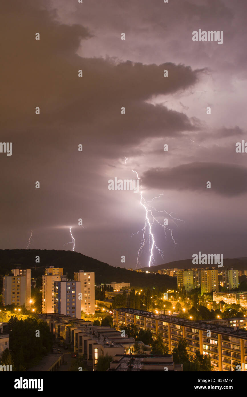 Storm over the city in night - Stock Image