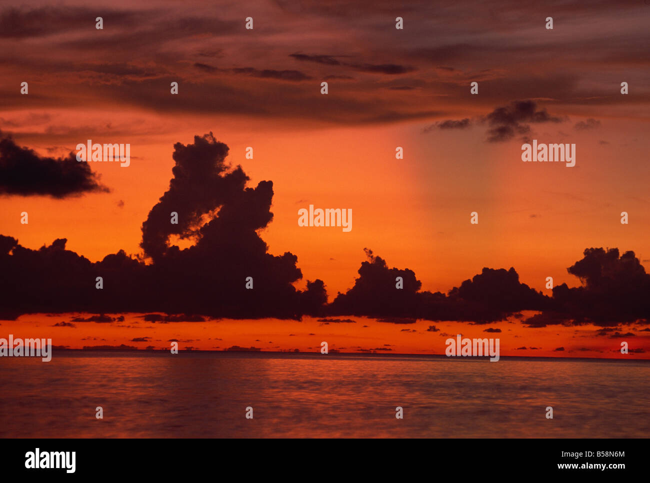 Tropical sunset off Seven Mile Beach, Cayman Islands, West Indies, Central America - Stock Image