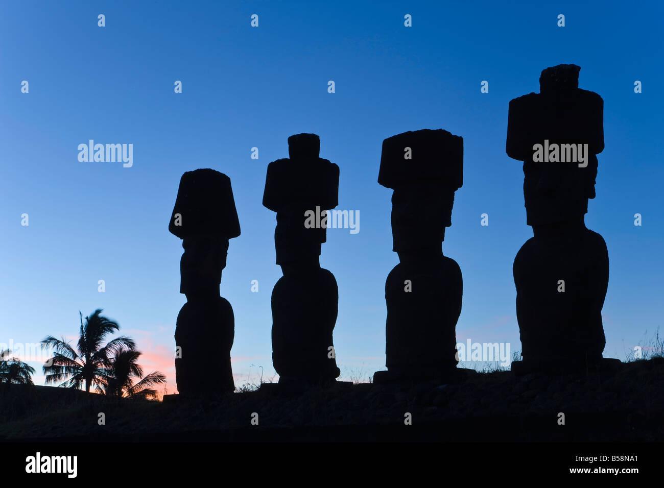 Anakena beach, Moai statues of Ahu Nau Nau, four of which have topknots, Rapa Nui, Chile - Stock Image