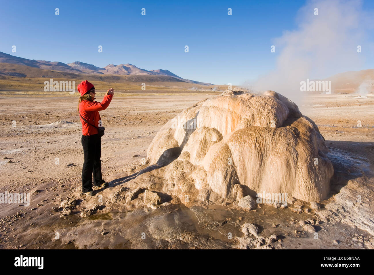 El Tatio Geysers, the area is ringed by volcanoes and fed by 64 geysers, Atacama Desert, Norte Grande, Chile - Stock Image