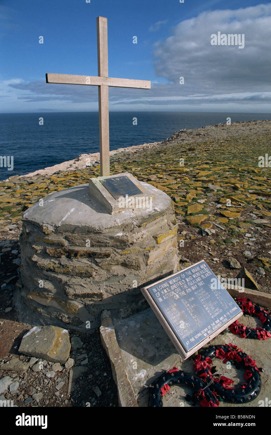 Poppy wreaths laid on the 1982 War Memorial to the dead of HMS Sheffield on Sealion Island in the Falkland Islands - Stock Image