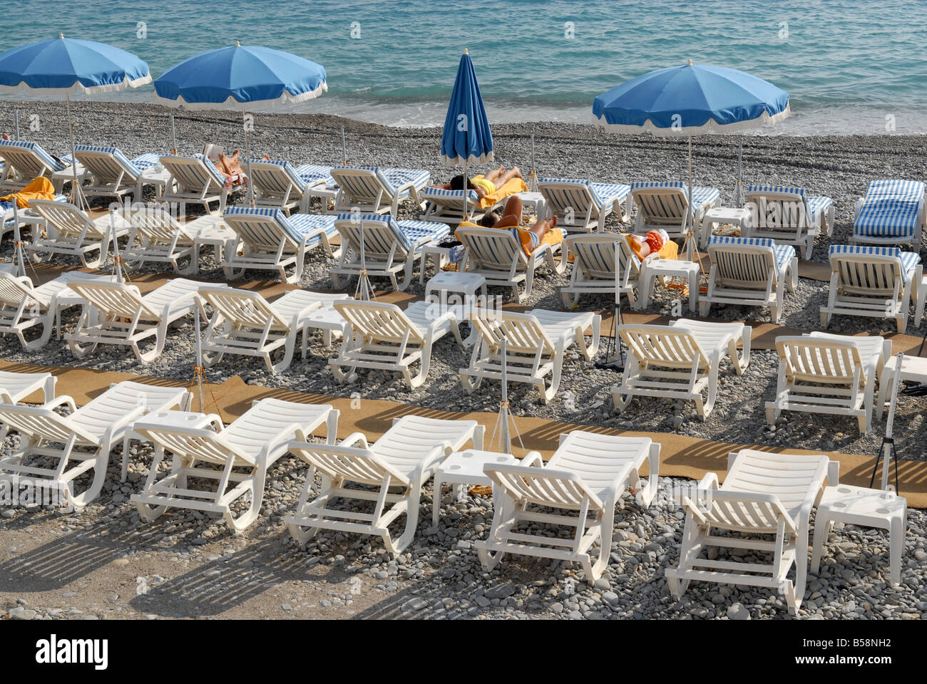 Sun loungers on the beach at Nice in France - Stock Image
