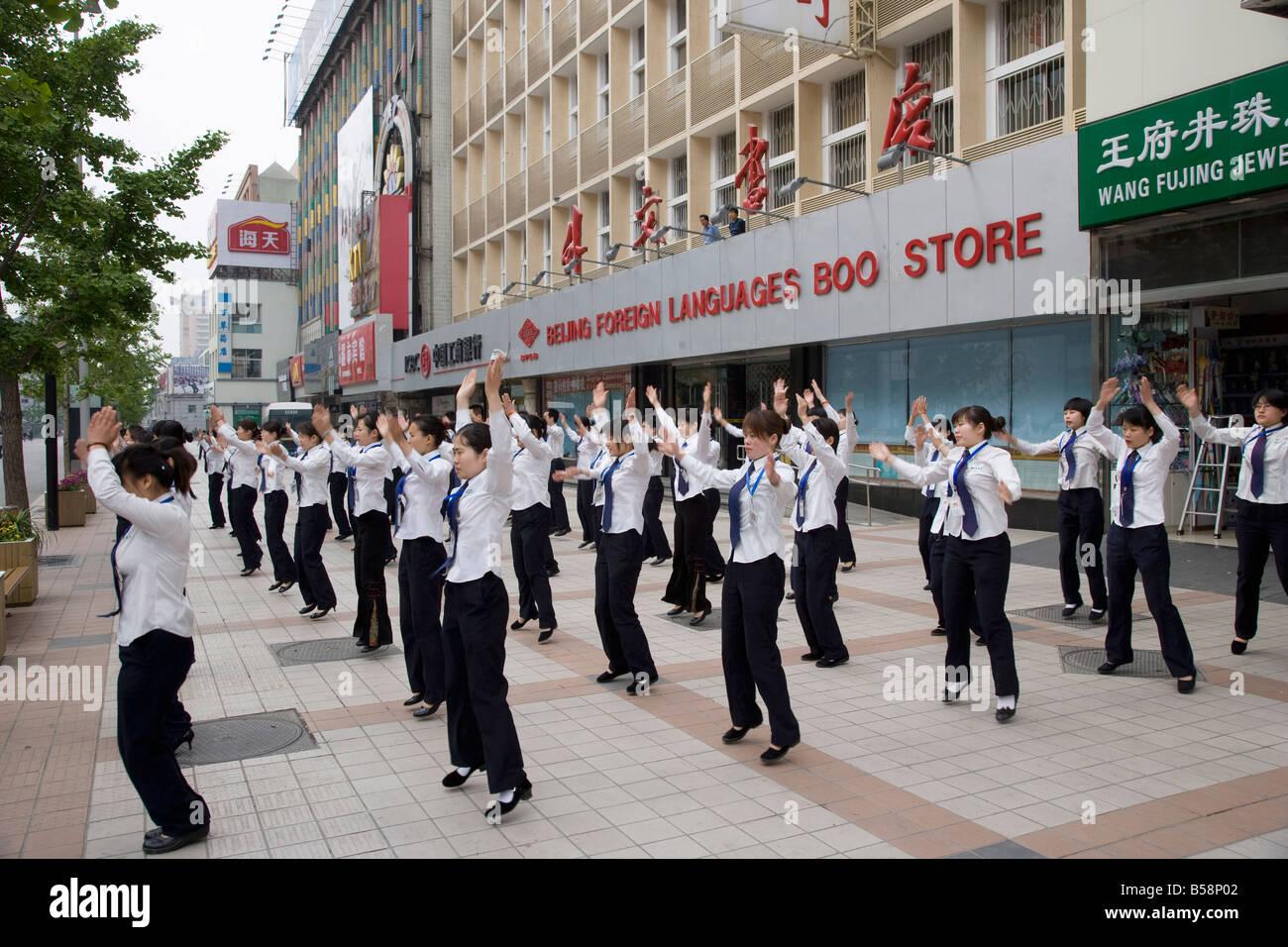 Store workers exercising before work, Wangfujing Road, Beijing, China - Stock Image