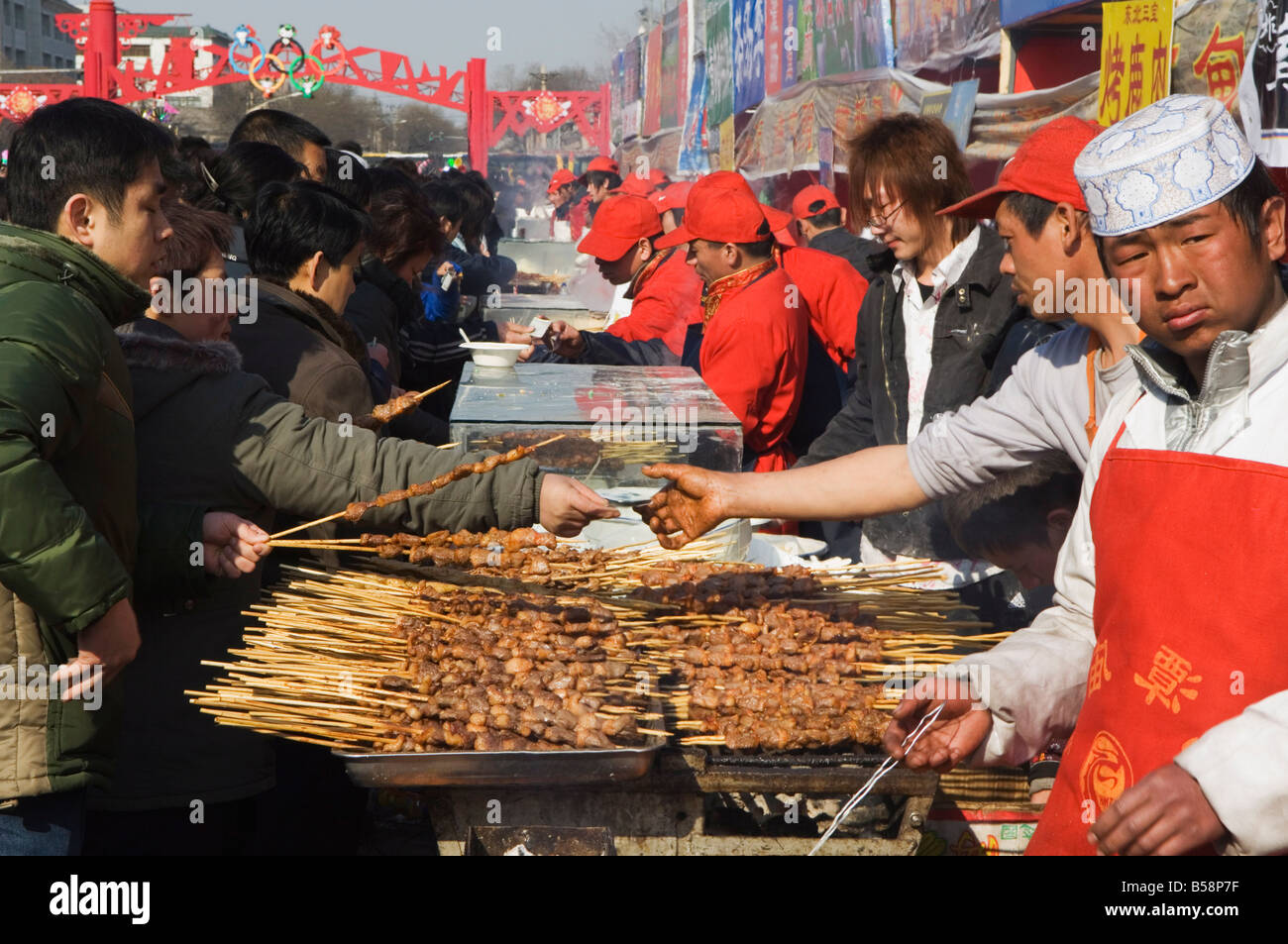 Food stalls selling meat sticks at Changdian Street Fair during Chinese New Year, Spring Festival, Beijing, China - Stock Image