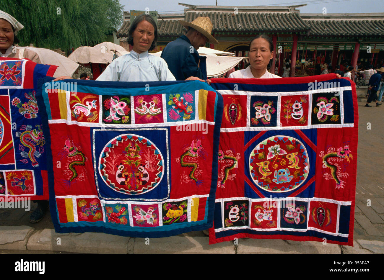 Women selling embroidered cloths Xian China Asia - Stock Image